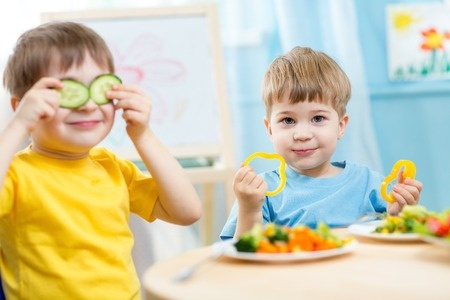 35227011 - kids eating healthy food in kindergarten or at home