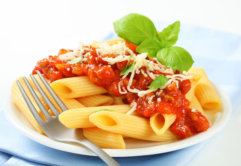 Penne pasta with meat-based tomato sauce and cheese